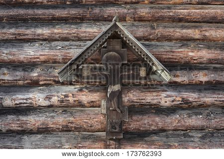 Jesus. Crucifixion. Russian wooden church. Traditional architecture in the culture of Russia. Orthodox Christian Church of the Intercession of the Holy Virgin. St. Petersburg.