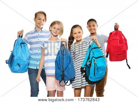 Cute schoolchildren, isolated on white