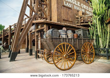 PORT AVENTURA/ SPAIN - MAY 11, 2015. Old wooden wagon near the attraction Wild Buffalos in the Far West area of theme park Port Aventura in city Salou, Spain.
