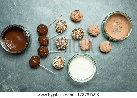 Overhead Of Energy Balls, Melted And Powder Chocolate, And Coconut