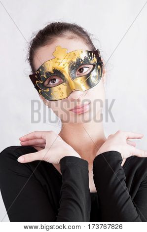 Girl Brunette In A Theatrical Mask Put Her Hands On His Shoulders