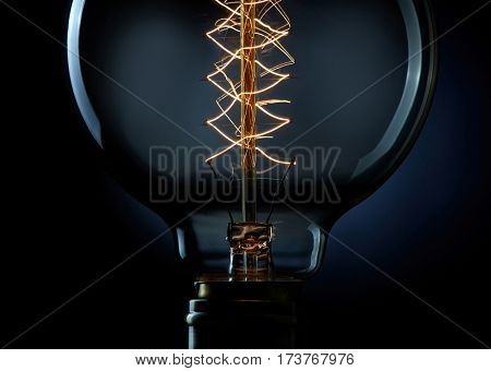Close up of light bulb over black background