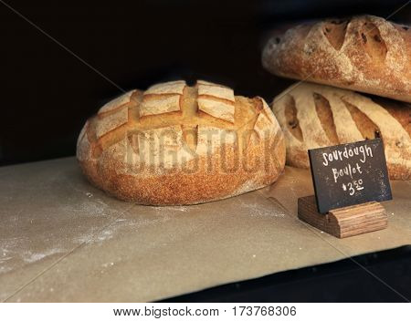 Freshly baked white bread on the counter of Market