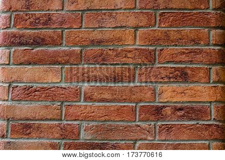 pattern created by cooked clay bricks get togheter to build a wall