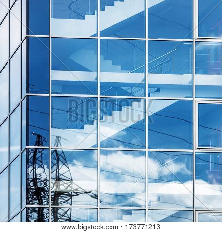 Modern business industrial architecture. Close-up photo of modern office building of steel and glass.