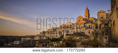 sunset lights the curch in Matera Italy