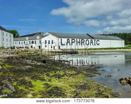 ISLAY, SCOTLAND - SEPTEMBER 11 2015: The sun shines on Laphroaig distillery warehouse