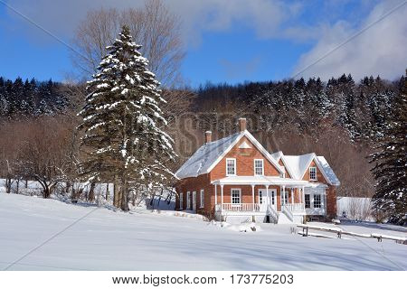 BROMONT QUEBEC CANADA 02 02 2017: Typical canadian house design has long needed to be adapted to Canada's climate and geography, and at times has also reflected the uniqueness of Canadian culture.