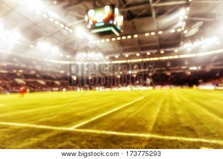 Blurred Field With Lights And Full Of Spectators At The Stadium One Step At A Sporting Event