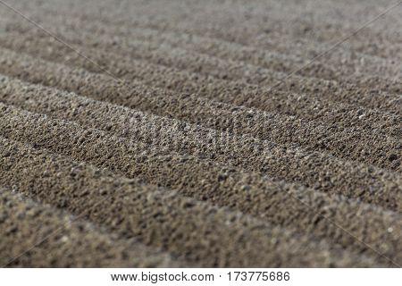 newly furrowed brown farmland with symmetrical furrows