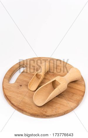 Wooden Measuring Scoops On The Wooden Kitchen Board