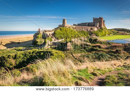 Elevated View of Bamburgh Castle, viewed from an elevated hillock, on the Northumberland coastline