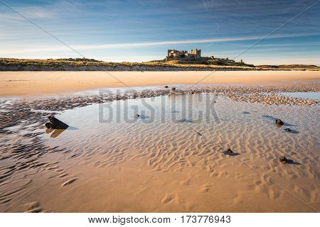 Shipwreck remains below Bamburgh Castle, on Bamburgh Beach at low tide, lies an unknown wooden shipwreck
