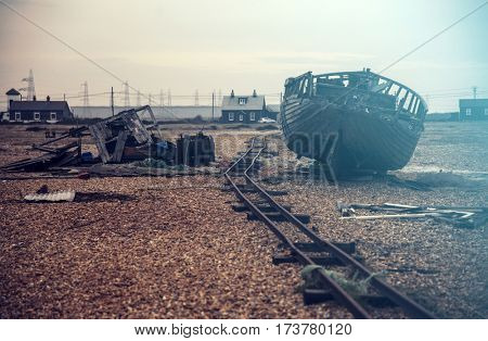 Old wooden fishing boat forgetten at Dungeness, Kent, England - retro styled photo