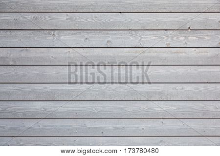 horizontal part of horizontal planks with light grey varnish