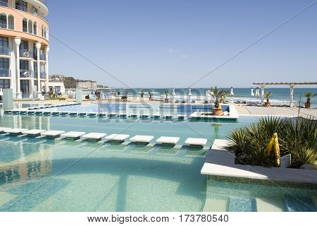 SAINT CONSTANTINE AND HELENA BULGARIA - APRIL 10 2015: swimming pool and beach of hotel Azalia in Saint Constantine and Helena is the oldest first sea resort of Bulgaria exists from 19 century.