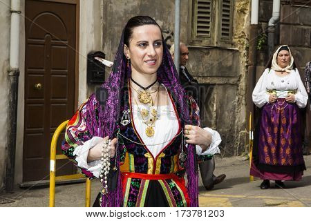 CAGLIARI, ITALY - May 1, 2013: 357 Religious Procession of Sant'Efisio - portrait of a beautiful girl in traditional Sardinian costume - Sardinia