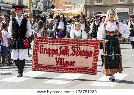QUARTU S.E., ITALY - September 15, 2013: Wine Festival in honor of the celebration of St. Helena - Parade of San Biagio folk group of Villasor - Sardinia