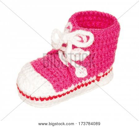 Handmade pink baby booties isolated on white background