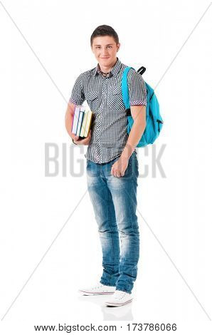 Full length portrait of a caucasian guy student of college or university with backpack and books. Casual young male isolated white background. Teen boy look at camera.