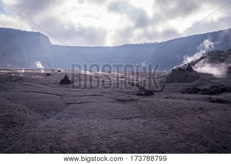 View of smoking big crater in Volcanoes National Park, Big Island of Hawaii, US
