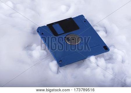 Blue floppy disk. Retro and old fashioned.Selective focus