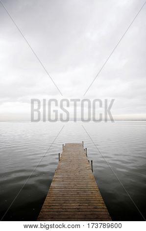 View of a wooden pier in Albufera lake, Valencia, Spain.
