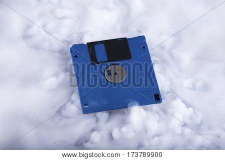 Floppy disk Retro information storage. Information cloud. Conceptual. Selective focus