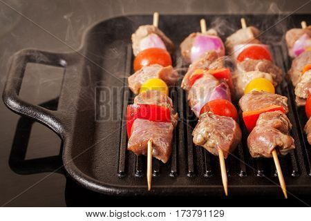 Fresh Turkey Meat Skewers With Cherry Tomatoes, Pepper And Onion Cooking On Grill