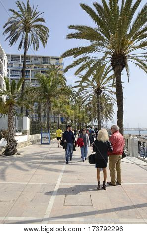 MARBELLA, SPAIN - FEBRUARY 26, 2017: People walking by the promenade in the town of Marbella Andalusia Spain