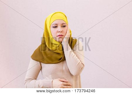 Arab saudi emirates woman with head ache isolated on a white background