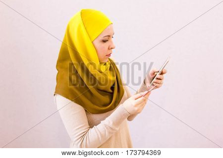Woman Holding Credit Card And Smartphone Checking Account. Buy Online