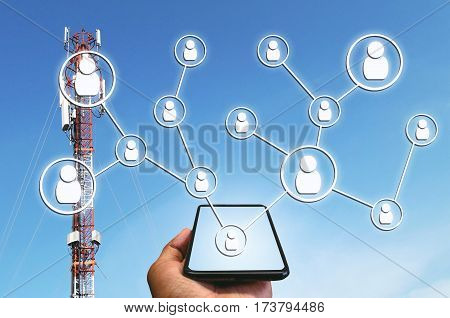 phone on hand and icon social media concept with telecommunication tower in blue sky as background, color tone effect.