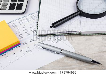 Electronic Calculator, Magnifying Glass, Notepad, Pen On Printout