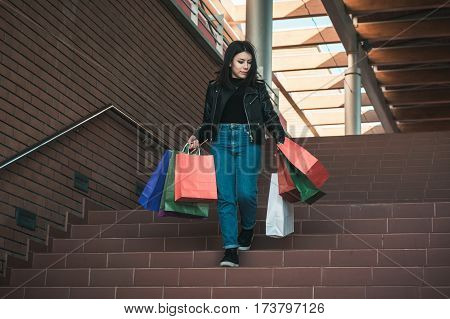 Happy girl making shopping in the shopping center