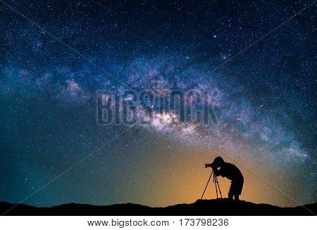 Landscape with Milky way galaxy. Night sky with stars and Photographer take photo on the mountain.