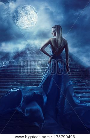Woman Climb Up Stairs to Fantasy Moon Heaven Fairy Girl in Night Blue Dress Model Back View Looking over Shoulder