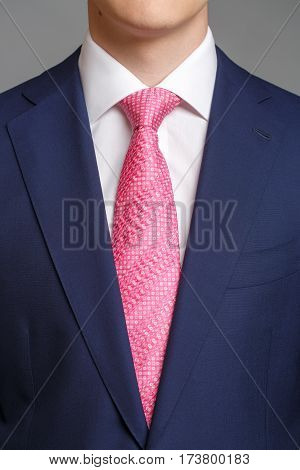 Man In Blue Tuxedo With Pink Tie