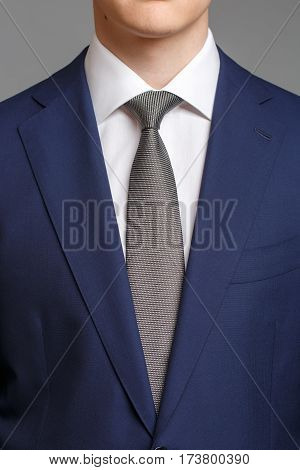 Man In Blue Tuxedo With Grey Tie
