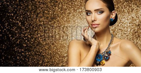 Fashion Model Makeup Portrait Elegant Woman in Necklace Jewelry touching Face Beautiful Slim Lady Make Up