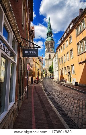 HANNOVER GERMANY - JUNE 9: Street view on Church of Holy Cross in Hanover in Germany. Hannover or Hannover is a city in Lower Saxony of Germany in 2012