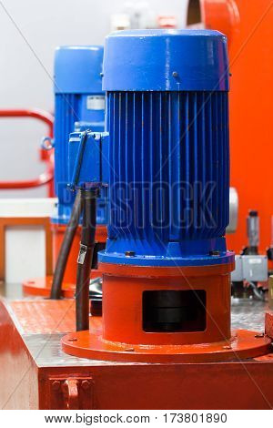 Induction electric motor in industrial hydraulic application.