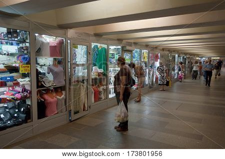 Moscow Russian Federation - July 25 2012: Shops open twenty-four hours in the subway underground passage. A woman stops to look at a shop window.