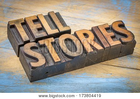 tell stories word abstract - text in vintage letterpress wood type - storytelling concept
