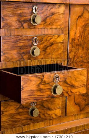 Wooden Cabinet With Opened Drawer