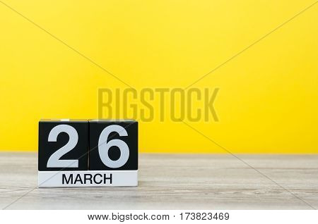 March 26th. Image of march 26 wooden color calendar on white background. Spring day, empty space for text. Purple DAy is the international day for epilepsy awareness