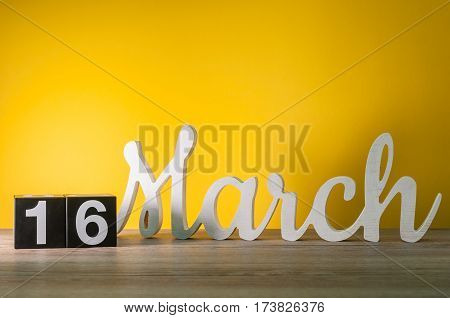 March 16th. Image of march 16 wooden color calendar on white background. Spring day, empty space for text.