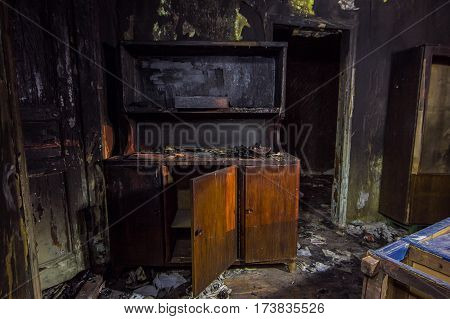 Interior of the burned by fire house, burned furniture