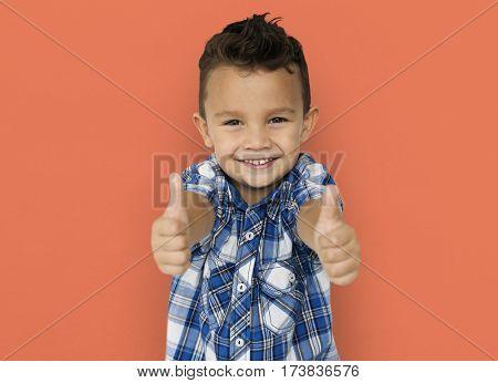 Little Boy Two Thumbs Up Studio Portrait Concept