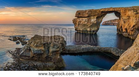 Gozo Malta - Panoramic view of the beautiful Azure Window a natural arch and famous landmark on the island of Gozo at sunset